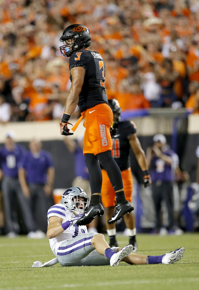 Photo - Oklahoma State's Tre Sterling (3) celebrates breaking up a pass intended for Landry Weber (12) in the third quarrter during the college football game between the Oklahoma State Cowboys and the Kansas State Wildcats at Boone Pickens Stadium in Stillwater, Okla., Saturday, Sept. 28, 2019. [Sarah Phipps/The Oklahoman]