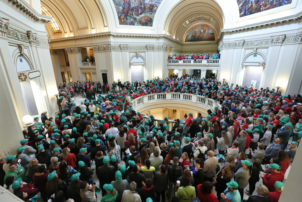 Photo - The fourth floor rotunda spills over with rally participants. Advocates for mental health care descended upon the state Capitol Tuesday morning, Oct. 24, 2017, to demand that lawmakers come up with a budget solution that includes funding for mental health services. Photo by Jim Beckel, The Oklahoman