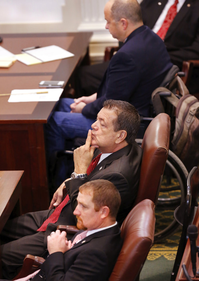 Photo -  Rep. Kirby, center, at his desk as he and fellow legislators follow the debate on the floor of the House. State representatives meet for an organizational day in the House chamber on Tuesday, Jan. 3, 2017. Initial discussion focused on the resignation/non-resignation of Rep. Dan Kirby, Tulsa, who has been accused of sexual harassment with a former staff member. [Photo by Jim Beckel, The Oklahoman]