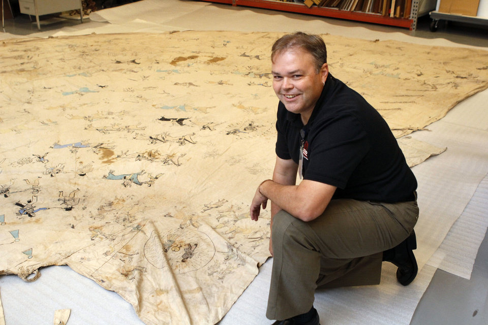 Photo - American Indian Collections Curator Matt Reed is overseeing the preservation of a nearly 100 year old teepee at the Oklahoma History Center in Oklahoma City, OK, Monday, August 19, 2013,  Photo by Paul Hellstern, The Oklahoman