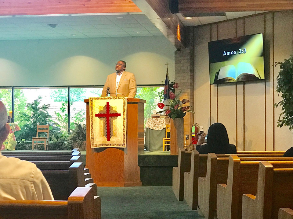 Photo -  The Rev. Dwayne Rodgers, senior minister of Wildewood Christian Church (Disciples of Christ), preaches a sermon on Sept. 30 at Western Oaks Christian Church (Disciples of Christ), 8100 NW 23. [Photo by Carla Hinton, The Oklahoman]