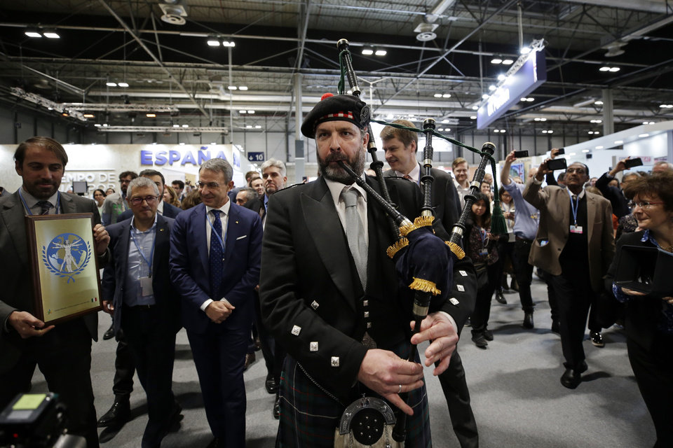 Photo -  A bagpipe player accompanies a UK delegation to promote COP26 to be held in Glasgow, at the COP25 climate talks congress in Madrid, Spain, Friday, Dec. 13, 2019. (AP Photo/Paul White)
