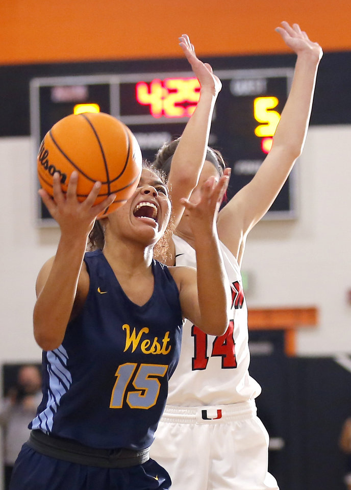 Photo - Putnam City West's Cimmonea Singleton shoots as Union's Makenzie Malham during the girls championship game between Putnam City West and Tulsa Union at the Putnam City Invitational at Putnam City High School in Oklahoma City, Okla.,  Saturday, Jan. 11, 2020.  [Sarah Phipps/The Oklahoman]