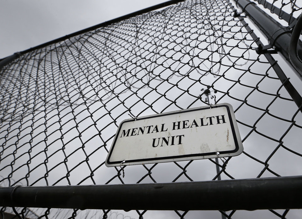Photo - Fences and razor wire surround the mental health unit at Joseph Harp Correctional Center on Feb. 23, 2016 in Lexington, Okla. Photo by Steve Sisney, The Oklahoman