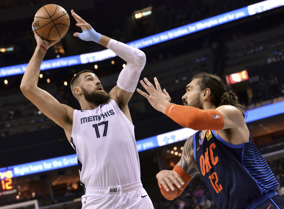 Photo - Memphis Grizzlies center Jonas Valanciunas (17) shoots against Oklahoma City Thunder center Steven Adams (12) during the first half of an NBA basketball game Monday, March 25, 2019, in Memphis, Tenn. (AP Photo/Brandon Dill)