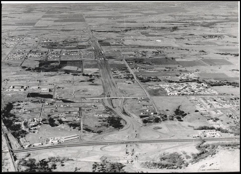 Photo - HIGHWAYS / CITY / EXPRESSWAYS / BROADWAY EXTENSION: UNKNOWN: Caption reads, HIGHWAY CONSTRUCTION looks different from the air. Staff Photo by Jim Lucas. Original Photo 02/04/1961. Published on T-3-23-61.