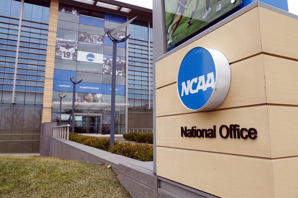 Photo - FILE - In this March 12, 2020, file photo, The national office of the NCAA in Indianapolis is viewed. The NCAA will permit spring sport athletes _ such as baseball, softball and lacrosse players _ who had their seasons shortened by the coronavirus outbreak to have an additional year of eligibility. The NCAA Division I Council voted Monday, March 30, 2020, to give spring sport athletes regardless of their year in school a way to get back the season they lost, but did not guarantee financial aid to the current crop of seniors if they return to play next year. (AP Photo/Michael Conroy, File)