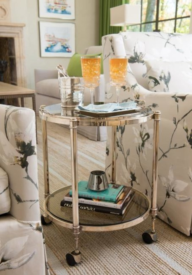"Photo -  Bar carts between chairs are replacing skirted tables in au courant French design, ""French Refreshed"" author Betty Lou Phillips says.  [DAN PIASSICK/"