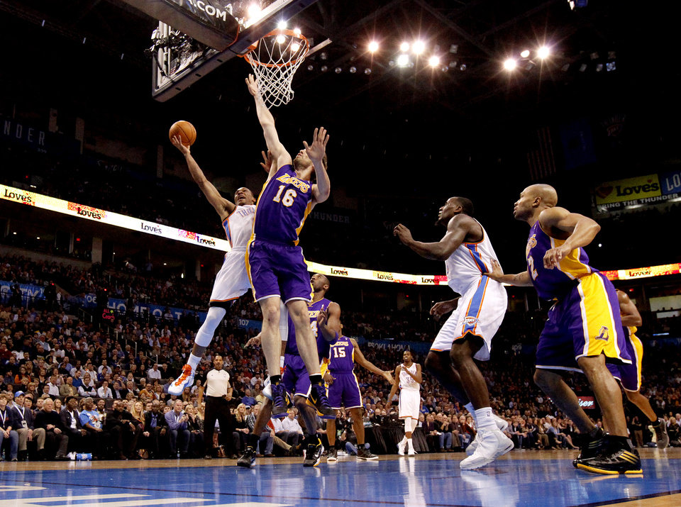 Photo - Oklahoma City's Russell Westbrook (0) goes to the basket beside Los Angeles' Pau Gasol (16) during an NBA basketball game between the Oklahoma City Thunder and the Los Angeles Lakers at Chesapeake Energy Arena in Oklahoma City, Thursday, Feb. 23, 2012. Photo by Bryan Terry, The Oklahoman