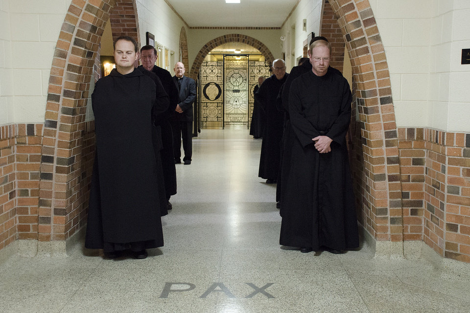 Photo -  Benedictine monks walk through the halls of St. Gregory's Abbey in Shawnee. [Photo by Theresa Bragg]