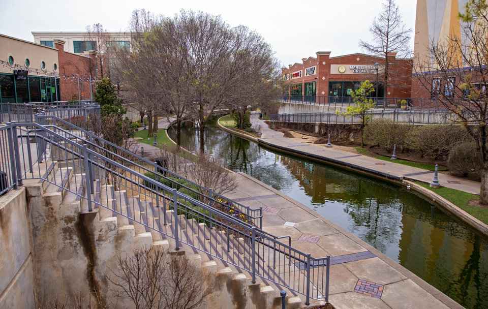 Photo -  The Bricktown Canal in Oklahoma City was quiet Monday, the first day of spring break in the state, a day that normally would have been busier. [Chris Landsberger/The Oklahoman]