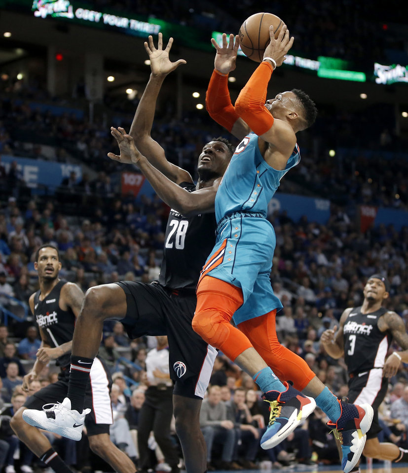 Photo - Oklahoma City's Russell Westbrook (0) tries to get past Washington's Ian Mahinmi (28) during an NBA basketball game between the Oklahoma City Thunder and the Washington Wizards at Chesapeake Energy Arena in Oklahoma City, Sunday, Jan. 6, 2019. Photo by Bryan Terry, The Oklahoman