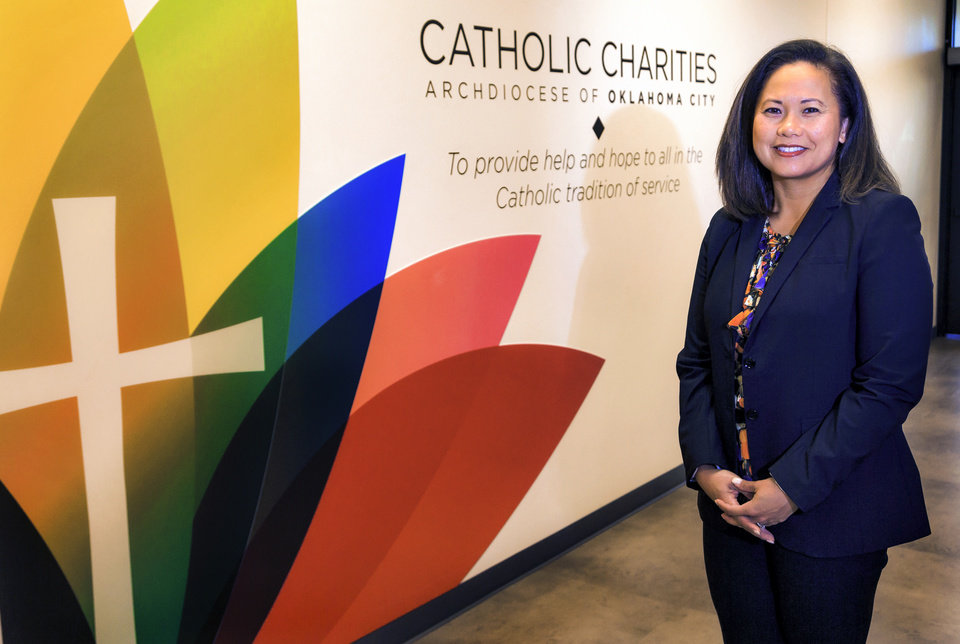 Photo -  President of the Catholic Charities of OKC board of directors, and Vietnamese immigrant, Vi Le, poses for a photo at the Catholic Charities' office on Aug. 31 in Oklahoma City. [Photo by Chris Landsberger, The Oklahoman]