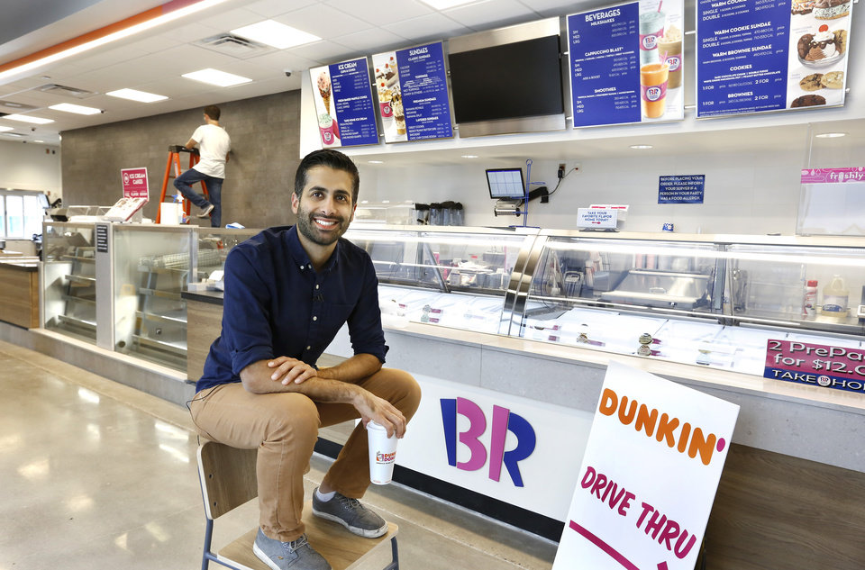 Photo -  Misha Goli takes a break inside his soon-to-open Dunkin Donuts/Baskin Robbins at 323 NW 23. [Photo by Jim Beckel, The Oklahoman]