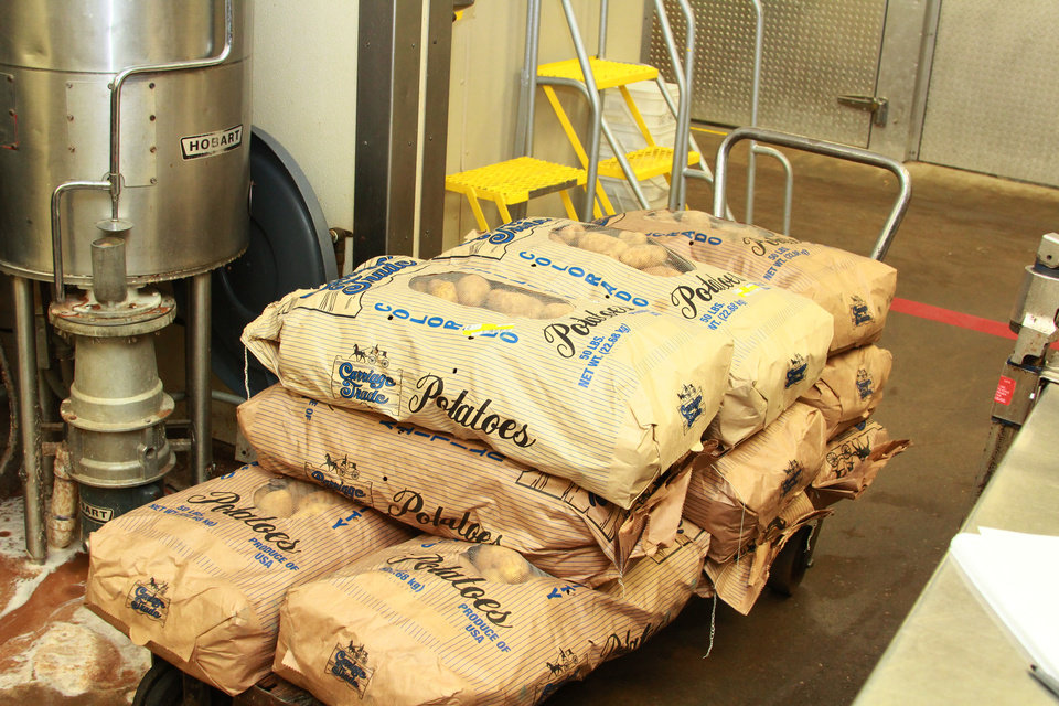 Photo -  Sacks of potatoes are stacked up in preparation for a Thanksgiving meal for the Joseph Harp Correctional Center. [Photo provided]