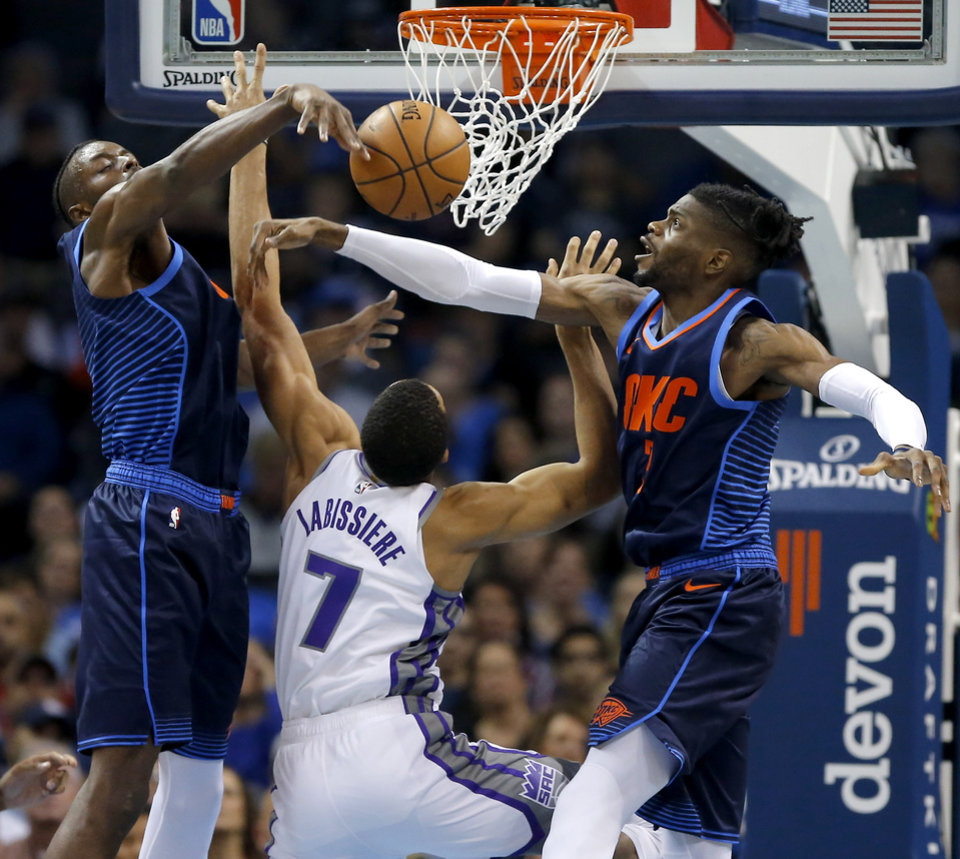 Photo - Oklahoma City's Jerami Grant (9) and Nerlens Noel (3) defend Sacramento's Skal Labissiere (7) during an NBA basketball game between the Oklahoma City Thunder and the Sacramento Kings at Chesapeake Energy Arena in Oklahoma City, Sunday, Oct. 21, 2018. Photo by Bryan Terry, The Oklahoman