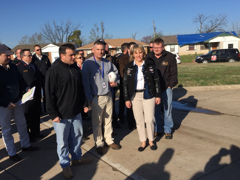 Photo - Gov. Mary Fallin arrives at a damaged elementary school in Moore Thursday morning. Photo by Jim Beckel
