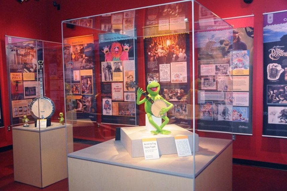 Photo - A display puppet of Kermit the Frog, complete with prop banjo, is on view in the exhibit