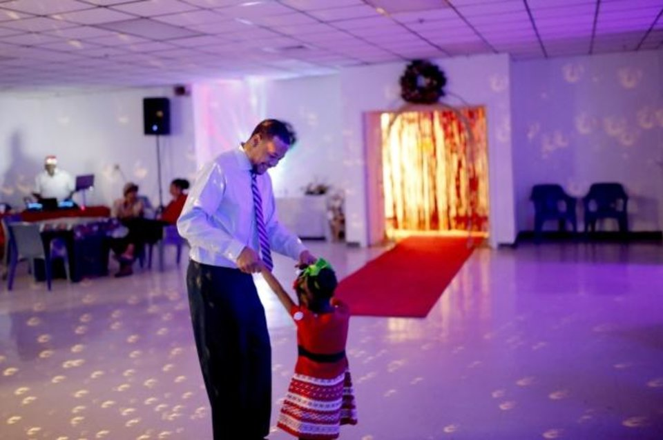Photo -  Mark Warner dances with his 4-year-old daughter during a Daddy-Daughter Social at Oklahoma City Transitional Living Center, a private community correctional center in south Oklahoma City. [Sarah Phipps/The Oklahoman]