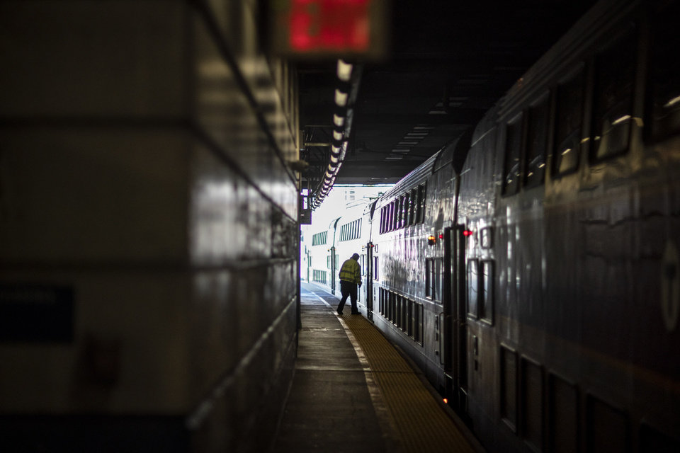 Photo -  A train employee boards the commuter rail heading to Boston after waiting for passengers, Friday, Nov. 20, 2020, in Providence, R.I. With the coronavirus surging out of control, the nation's top public health agency pleaded with Americans not to travel for Thanksgiving and not to spend the holiday with people from outside their household. (AP Photo/David Goldman)