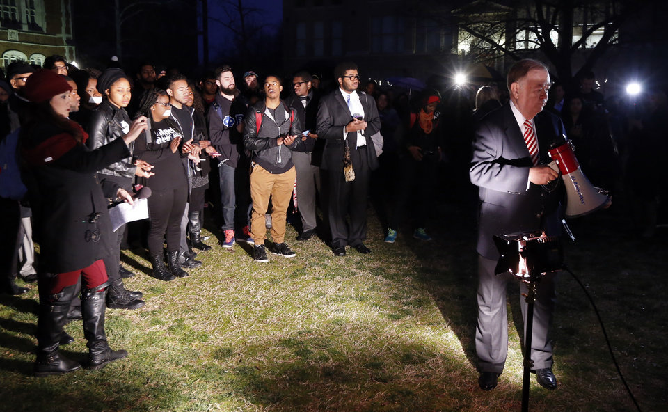 Photo - University of Oklahoma President David L. Boren speaks with students as they protest a campus fraternity's racist comments on March 9, 2015 in Norman, Okla. Photo by Steve Sisney, The Oklahoman