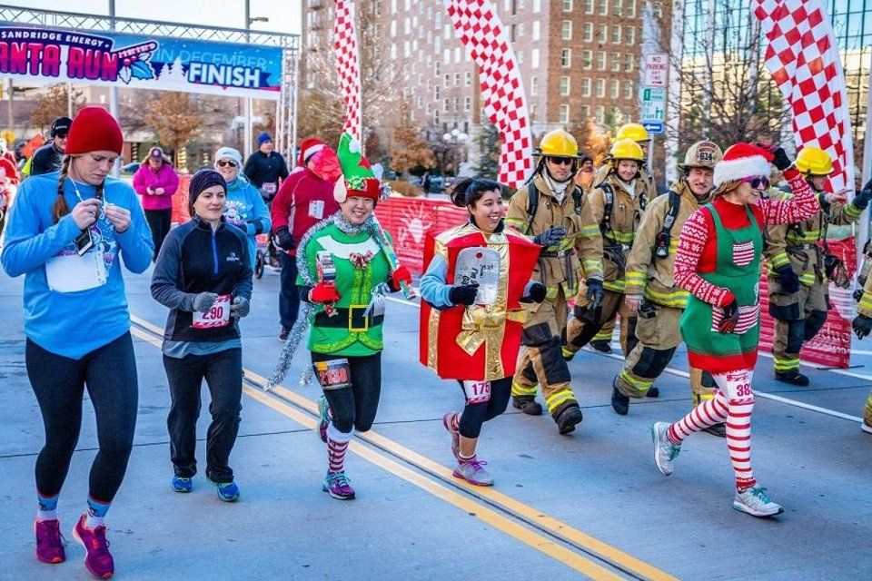 Photo - Runners participate in the 2017 Sandridge Santa Run, part of Downtown in December. [Photo provided]