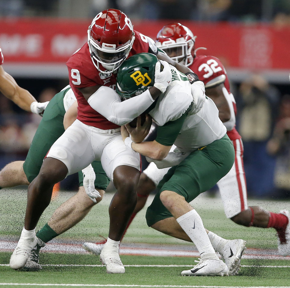 Photo - Oklahoma's Kenneth Murray (9) brings down Baylor's Charlie Brewer (12) during the Big 12 Championship Game between the University of Oklahoma Sooners (OU) and the Baylor University Bears at AT&T Stadium in Arlington, Texas, Saturday, Dec. 7, 2019. Oklahoma won 30-23. [Bryan Terry/The Oklahoman]