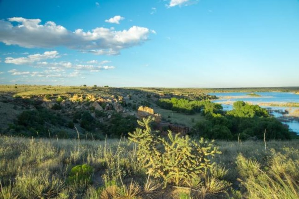 Photo -  At Black Mesa State Park in the Oklahoma Panhandle, you can hike to the top of the plateau, which is Oklahoma's highest point at 4,973 feet above sea level in the Black Mesa Nature Preserve. [Kim Baker/Oklahoma Tourism]