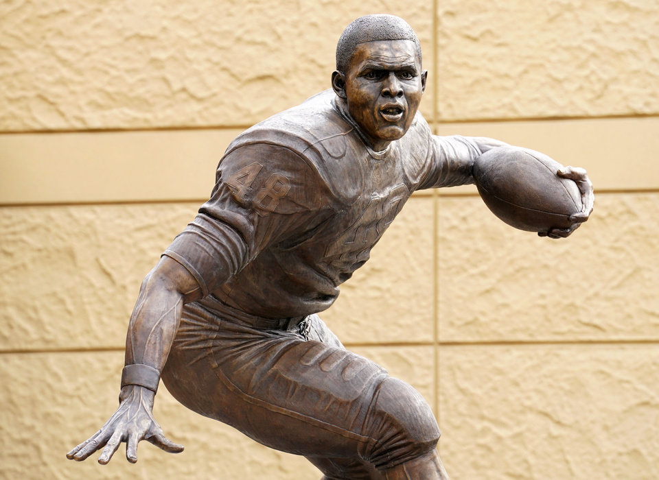 Photo - A statue of former Kansas Jayhawks running back Gale Sayers was unveiled during halftime of the game against Oklahoma State. [Jay Biggerstaff-USA Today Sports]