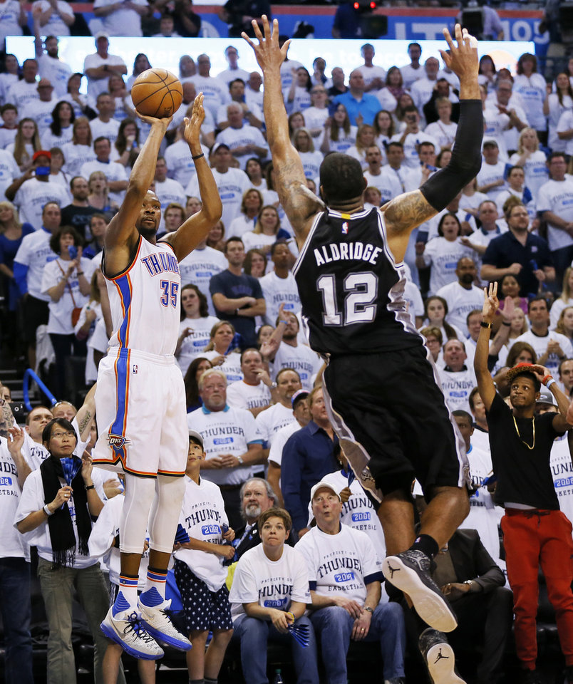 Photo - Oklahoma City's Kevin Durant (35) shoots a 3-point shot against San Antonio's LaMarcus Aldridge (12) in the fourth quarter during Game 4 of the Western Conference semifinals between the Oklahoma City Thunder and the San Antonio Spurs in the NBA playoffs at Chesapeake Energy Arena in Oklahoma City, Sunday, May 8, 2016. Oklahoma City won 111-97. Photo by Nate Billings, The Oklahoman