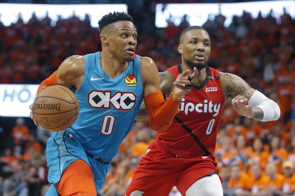 Photo - Oklahoma City's Russell Westbrook (0) goes past Damian Lillard (0) during Game 3 in the first round of the NBA playoffs between the Portland Trail Blazers and the Oklahoma City Thunder at Chesapeake Energy Arena in Oklahoma City, Friday, April 19, 2019. Photo by Bryan Terry, The Oklahoman