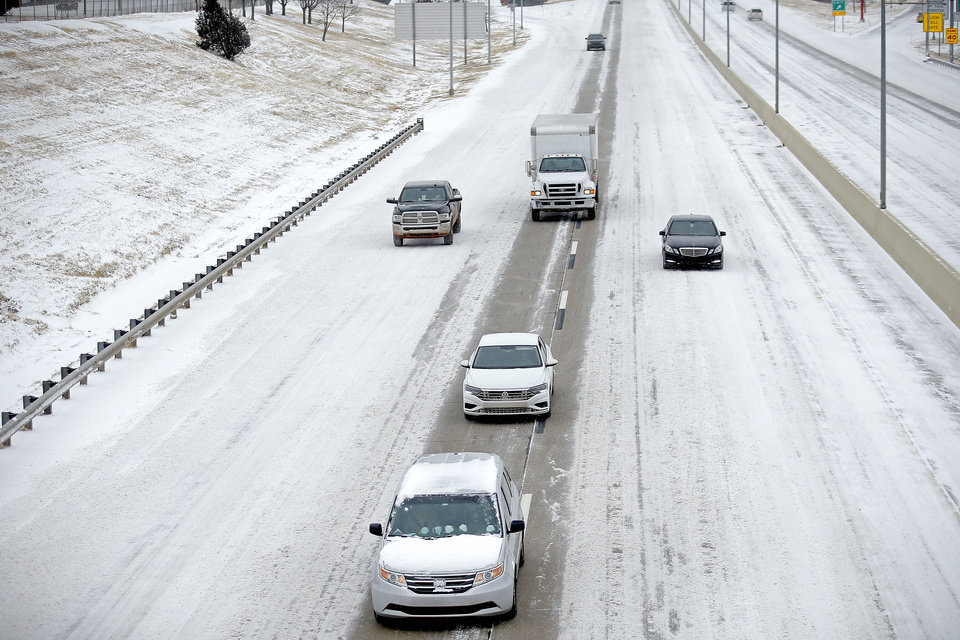 Photo - A cars travel west on the John Kilpatrick Turnpike in Oklahoma City, Sunday, Feb. 14, 2021. Photo by Sarah Phipps, The Oklahoman