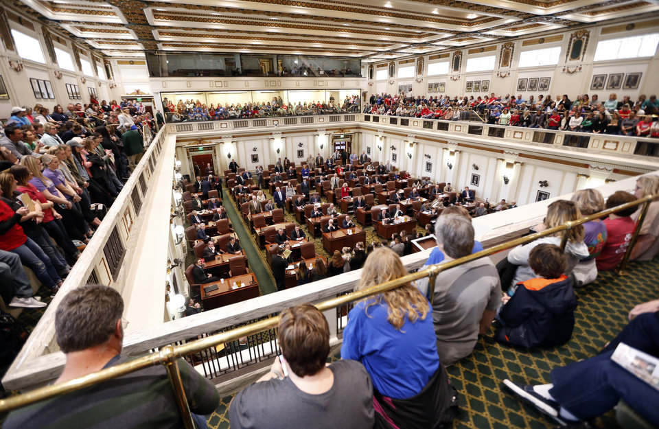 Photo -  Teachers fill the house gallery as they participate in a walkout at the state Capitol building on Thursday in Oklahoma City. [Photo by Steve Sisney, The Oklahoman]