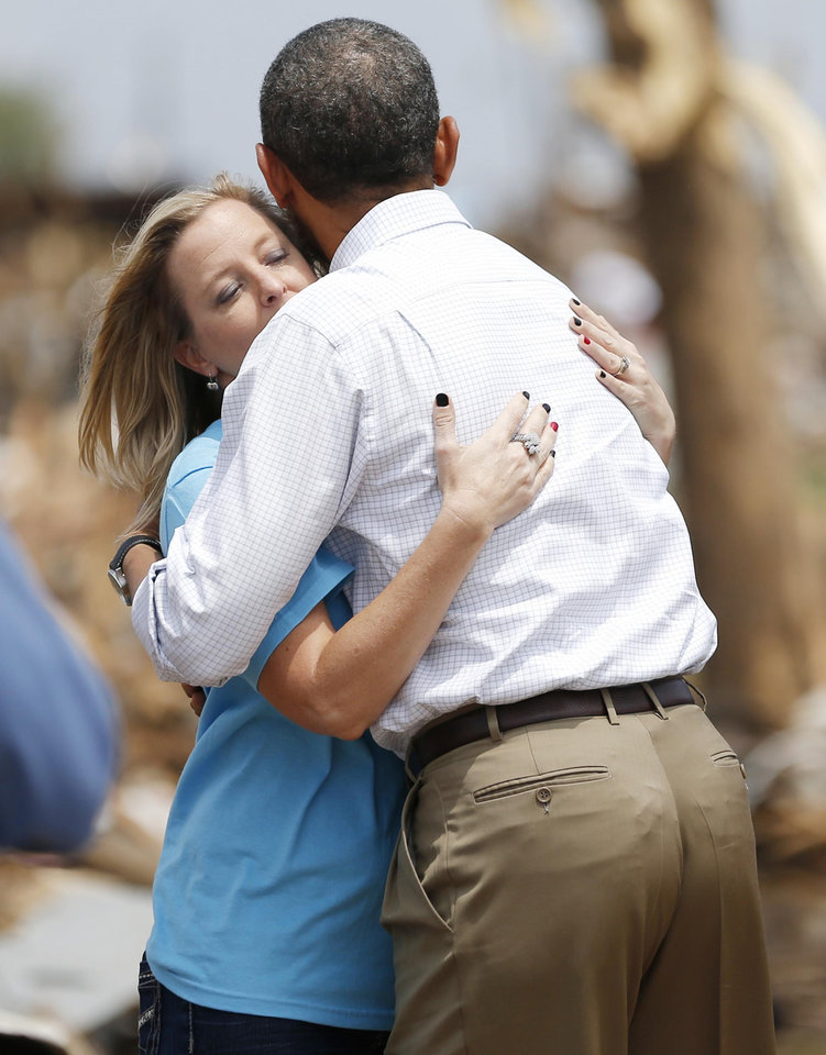 Photo - President Barack Obama hugs Plaza Towers Elementary School Principal Amy Simpson. Obama toured the area in Moore that was hit by the May 20 tornado. The twister claimed the lives of seven Plaza Towers students.