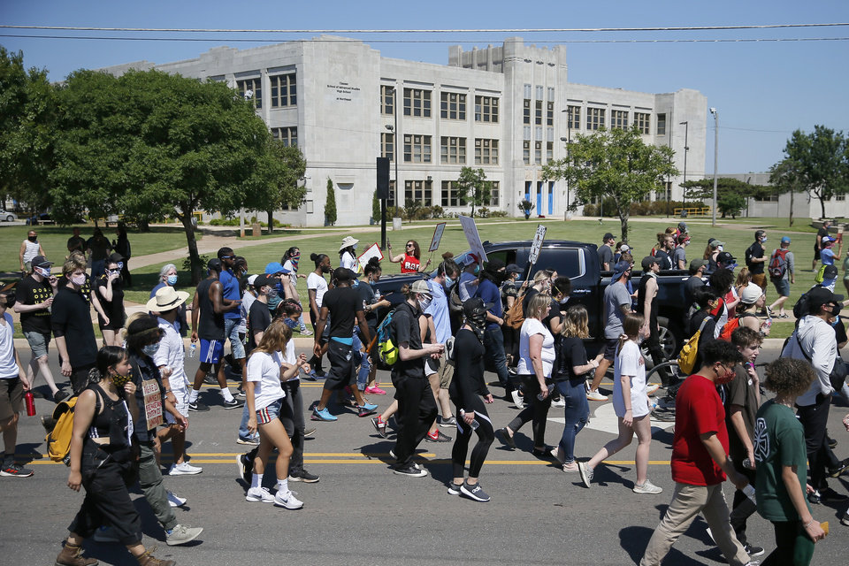 Photo - Protesters head south on Kelley in Oklahoma City on Sunday, May 31, 2020. The Black Lives Matter protest was in response to the death of George Floyd. [Bryan Terry/The Oklahoman]