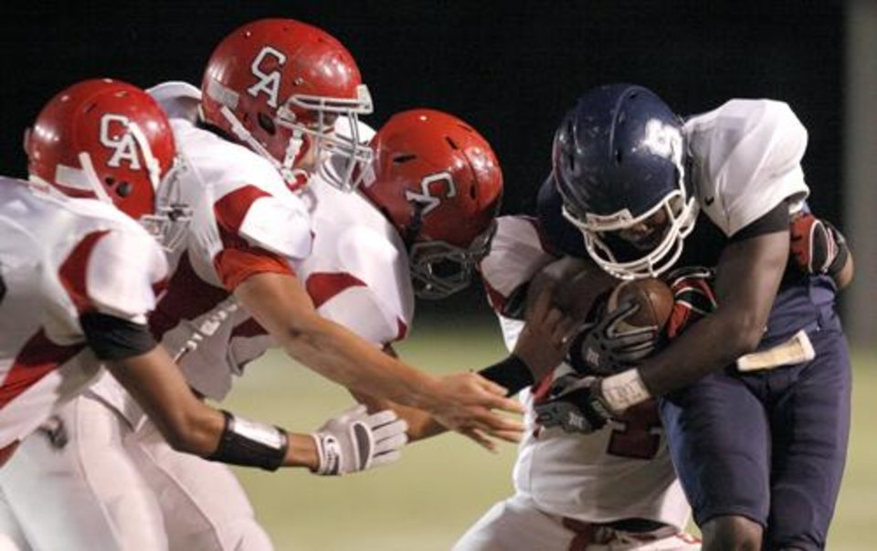 Photo -  Gabrion Frazier (1) is brought down Carl Albert defenders during the high school football game between Shawnee and Carl Albert Friday, 0ct. 2, 2009, at the Jim Thorpe Stadium in Shawnee, Okla. Photo by Sarah Phipps, The Oklahoman