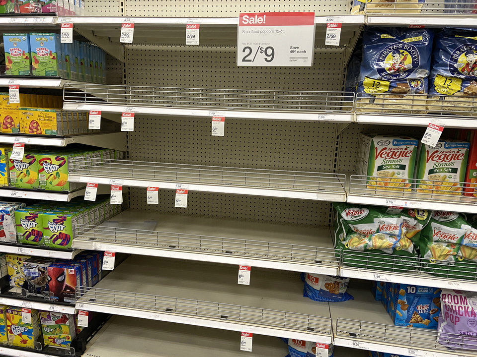Photo - Bare shelves in the popcorn section at the Super Target at Memorial and Penn., Friday, March 13, 2020.  [Photo by Doug Hoke/The Oklahoman]