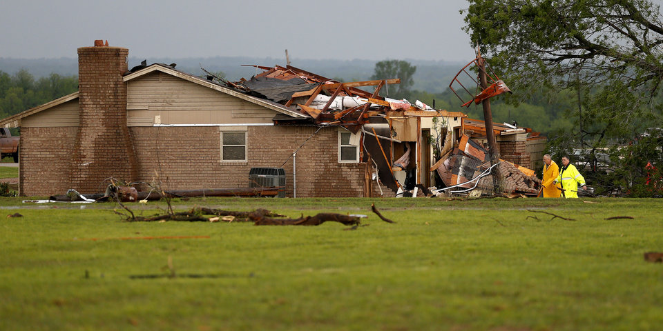 Photo - Emergency personal search a home that was damaged by a tornado just south of Carney, Okla., on Sunday, May 19, 2013. Photo by Bryan Terry, The Oklahoman