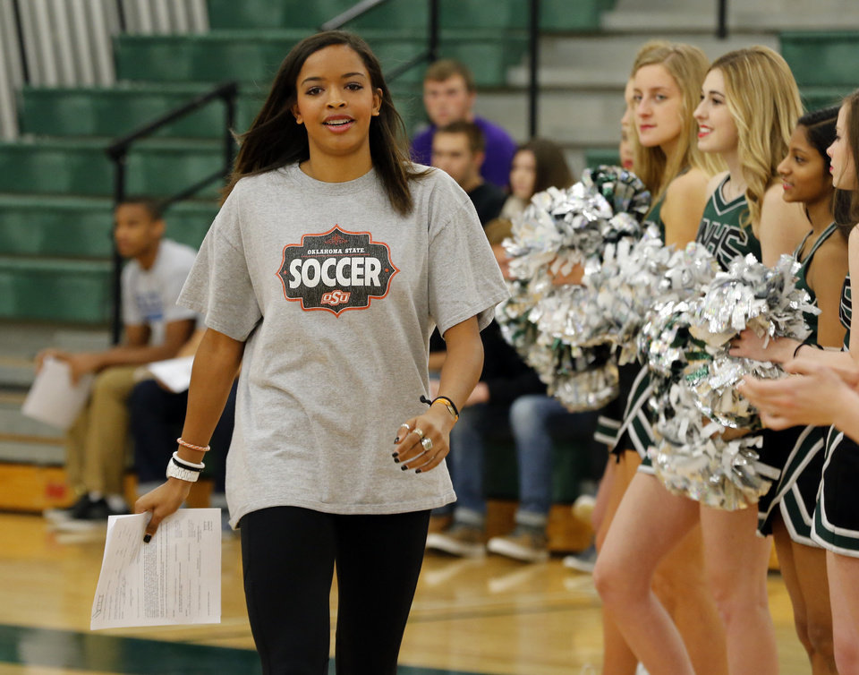 Photo - Haley Woodard is introduced as she makes her decision to attend Oklahoma State University official at Norman North High School on Wednesday, Feb. 4, 2015  in Norman, Okla. Photo by Steve Sisney, The Oklahoman