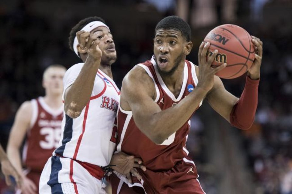 Photo -  Devontae Shuler and Mississippi couldn't do much to stop Oklahoma's Christian James, who tied for a game-high with 20 points Friday. [AP Photo/Sean Rayford]