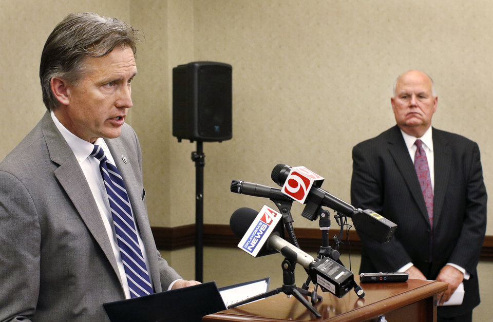 "Photo - Oklahoma Attorney General Mike Hunter, left,  and State Auditor Gary Jones discuss the grand jury's findings at an afternoon news conference at the office of the attorney general. Oklahoma's multicounty grand jury reported Thursday, May 17, 2018, that the financial crisis at the Oklahoma Health Department was never real. Grand jurors issued no indictments out of their six-month investigation, saying the state laws do not cover the misconduct they discovered. They reported both the layoffs at the Health Department and a $30 million emergency appropriation last year were unnecessary. ""The Department of Health was never insolvent,"" their 32-page report says. ""The Department had ample cash to pay all of its expenses, including payroll, through the end of the year,"" Photo by Jim Beckel, The Oklahoman"