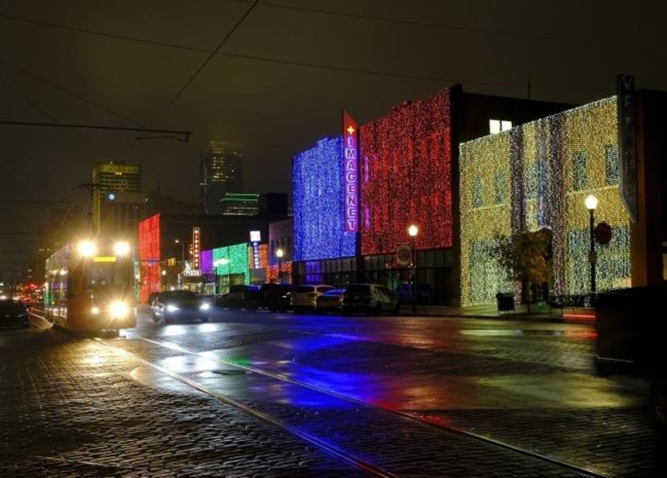 Photo -  Automobile Alley's distinctive draped holiday lights gleam Tuesday, November 24, 2020. The historic downtown OKC district dazzles this time of year, with more than 230,000 kaleidoscopic LED lights curtaining the buildings along 10 blocks of North Broadway and the side streets through Jan. 10. [Doug Hoke/The Oklahoman Archives]