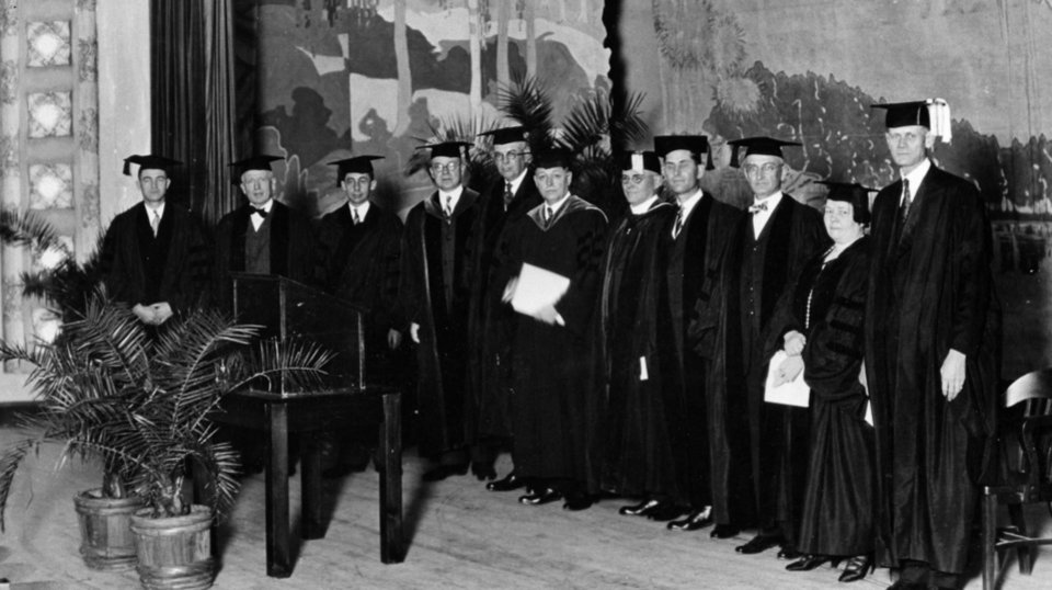 Photo -  Dignitaries on the stage of The Auditorium (now Holmberg Hall) in 1925 for the inauguration of William Bennett Bizzell as OU president. He served 1925-1941. [Photo Provided by OU]