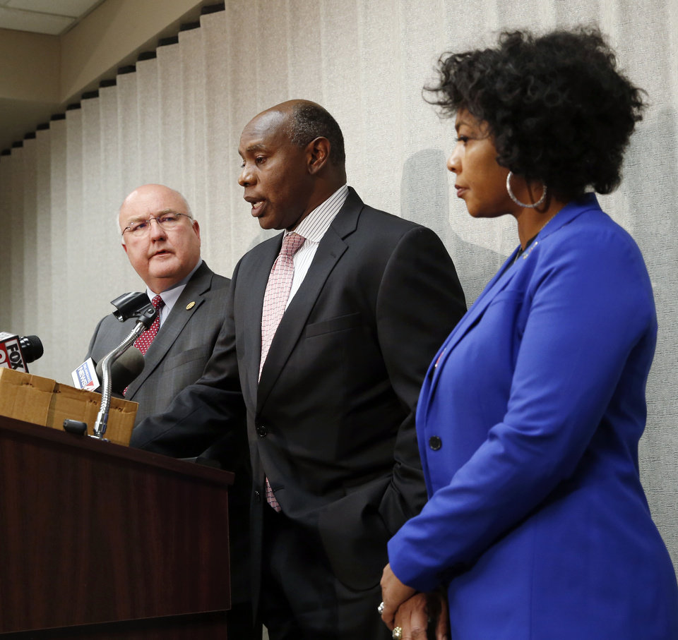 Photo - OSSAA executive director David Jackson, center, speaks next to OSSAA board president and Millwood superintendent Cecilia Robinson-Woods, right, and OSSAA board vice president and Guthrie superintendent Mike Simpson, left, during a press conference at the Oklahoma Secondary School Activities Association office announcing the postponement of OSSAA events, including the state basketball tournament, due to the new coronavirus, in Oklahoma City, Thursday, March 12, 2020. [Nate Billings/The Oklahoman]