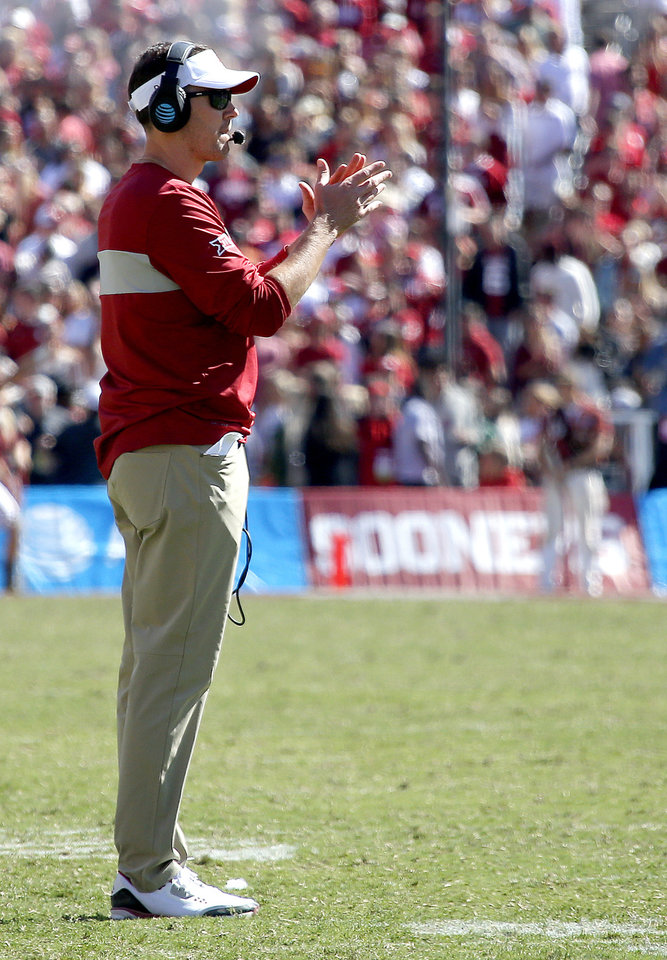 Photo - Oklahoma head coach Lincoln Riley takes a time out in the fourth quarter during the Red River Showdown college football game between the University of Oklahoma Sooners (OU) and the Texas Longhorns (UT) at Cotton Bowl Stadium in Dallas, Saturday, Oct. 12, 2019. OU won 34-27. [Sarah Phipps/The Oklahoman]