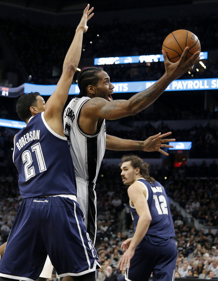 Photo - San Antonio's Kawhi Leonard (2) goes past Oklahoma City's Andre Roberson (21) during Game 1 of the second-round series between the Oklahoma City Thunder and the San Antonio Spurs in the NBA playoffs at the AT&T Center in San Antonio, Saturday, April 30, 2016. San Antonio won 124-92. Photo by Bryan Terry, The Oklahoman