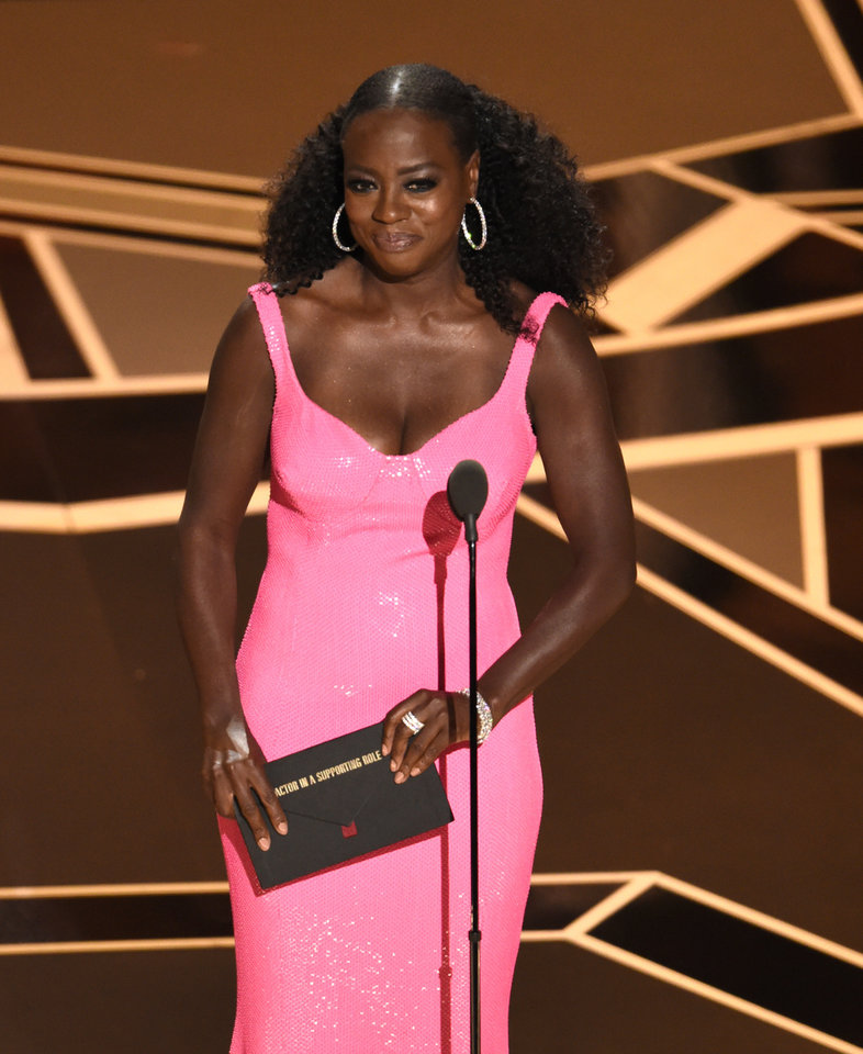 Photo - Viola Davis presents the award for best performance by an actor in a supporting role at the Oscars on Sunday, March 4, 2018, at the Dolby Theatre in Los Angeles. (Photo by Chris Pizzello/Invision/AP)