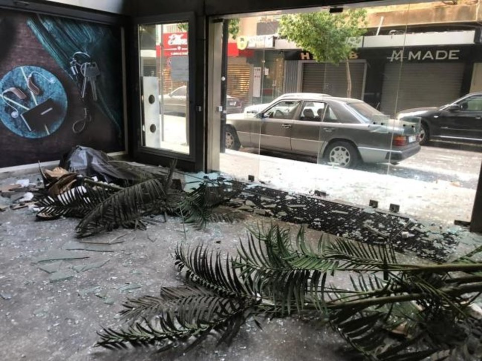 Photo -  In this photograph, debris and plants are shown along with a blown out plate glass window at a dental clinic run by a relative of an Oklahoma City Muslim leader. [Photo provided]