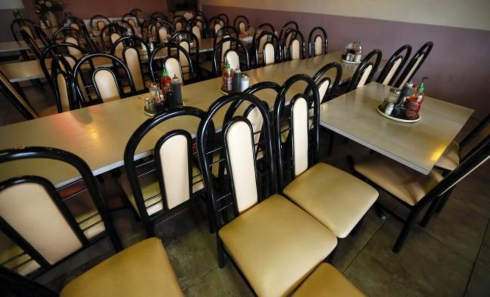 Photo -  Empty tables and chairs on Thursday inside Pho Ca Dao Vietnamese Noodle House in the Jade Asian Plaza in the Asian District in Oklahoma City. [Nate Billings/The Oklahoman]