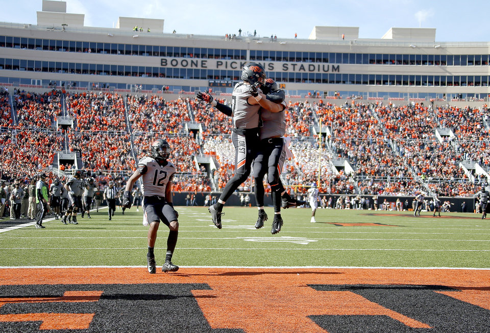Photo - Oklahoma State's Dillon Stoner (17) celebrates his touchdown with Landon Wolf (1) in the second quarter during the college football game between the Oklahoma State University Cowboys and the Kansas Jayhawks at Boone Pickens Stadium in Stillwater, Okla., Saturday, Nov. 16, 2019. OSU won 31-13. [Sarah Phipps/The Oklahoman]